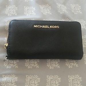 Michael Kors saffiano leather wallet.